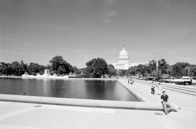 Tourists in front of the Capitol Reflecting Pool.