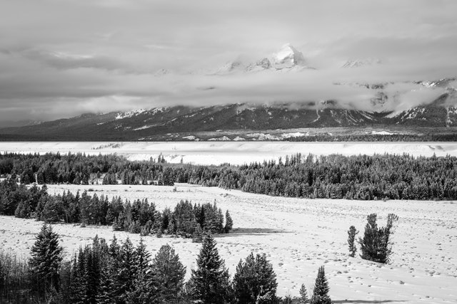 Buck Mountain, partially hidden by clouds during winter, from Teton Point turnout.