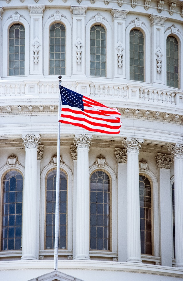 The flag of the United States, flying over the United States Capitol.