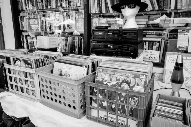 Vinyl albums and used books on a table at Capitol Hill Books.