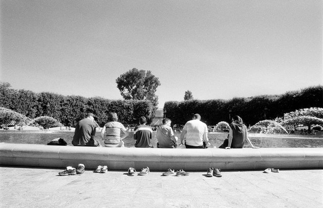Tourists dipping their feet in the fountain of the National Gallery of Art Sculpture Garden.