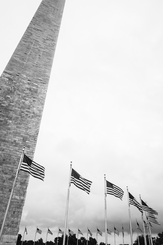 The Washington Monument, surrounded by flags.