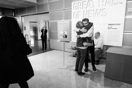 Pete Souza hugging a fan during a book signing at the Newseum.