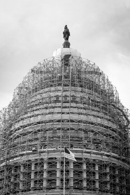 The dome of the United States Capitol building, covered in scaffolding.