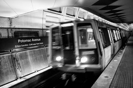 An Orange line train entering the Potomac Avenue Metro Station.