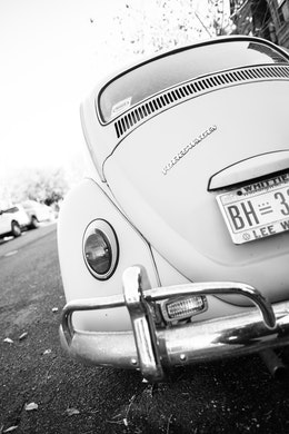 The rear end of a Volkswagen Beetle parked on Independence Avenue in Capitol Hill.