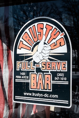 The Trusty's sign on the front window.