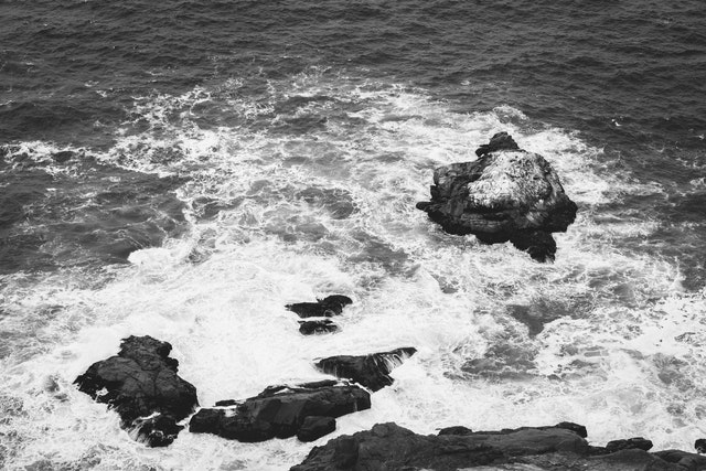 Waves breaking on the rocks at the bottom of the cliffs near the Point Reyes Lighthouse.