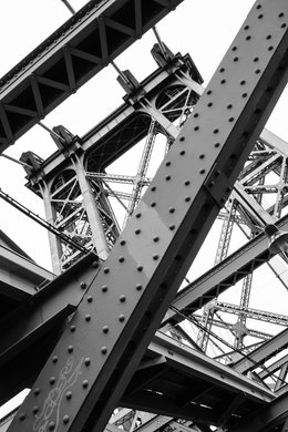 Looking up at the trusswork of one of the towers of the Williamsburg Bridge in New York City.