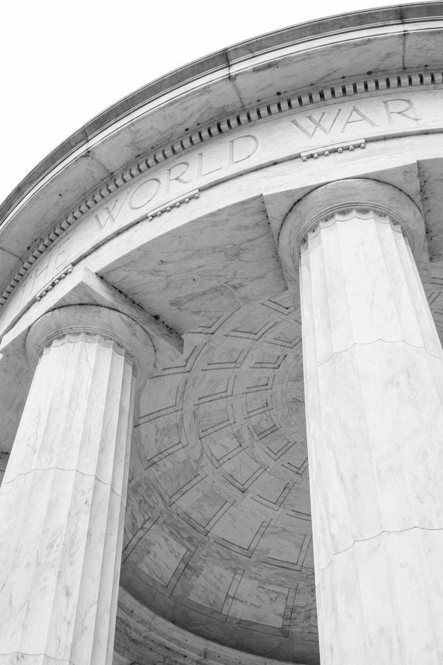 """Two columns and a section of the roof of DC War Memorial, reading """"the World War""""."""