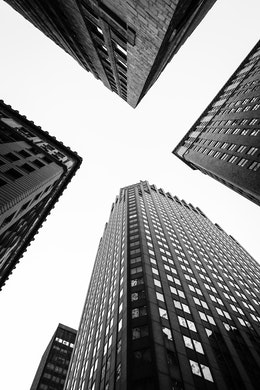 Looking up at buildings in New York's Financial District.