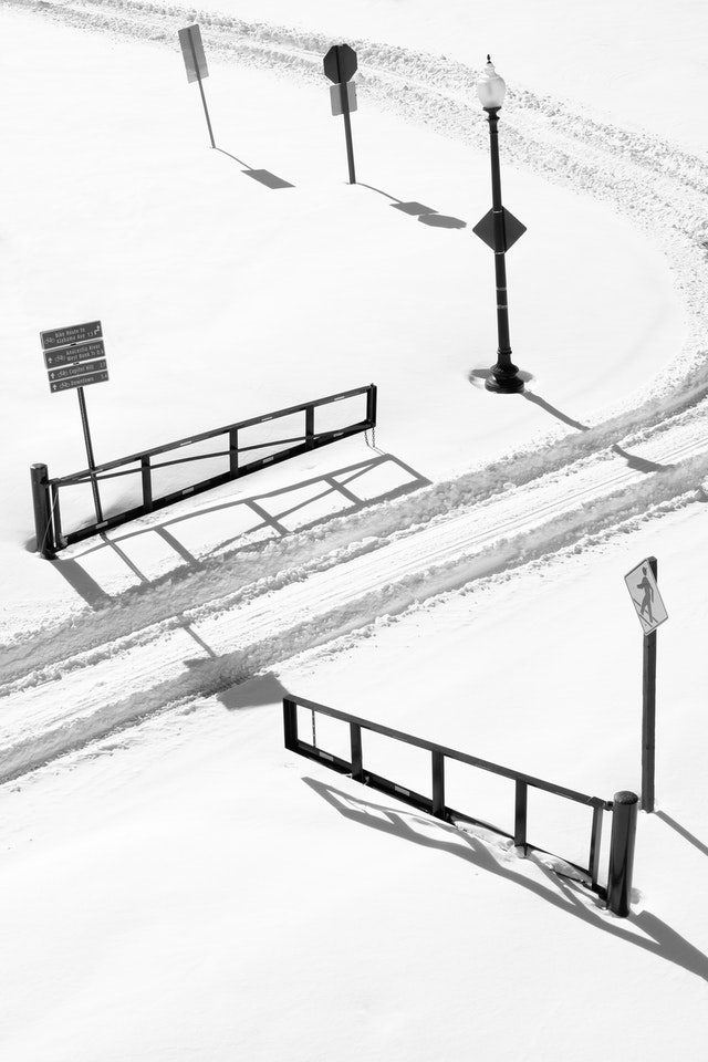 Tire tracks in the snow going through a gate at Anacostia Park.