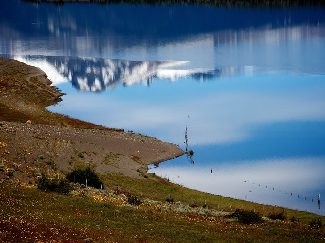Mountains reflected on the Lago Roca, Santa Cruz Province, Argentina.
