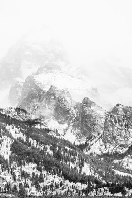 Grand Teewinot and Disappointment Peak, covered in snow and engulfed by a snowstorm.