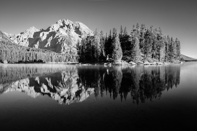 Boulder Island and Mount Moran, reflected on the surface of Leigh Lake.