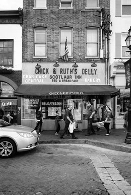 People walking on the street in front of Chick & Ruth's Delly in downtown Annapolis.