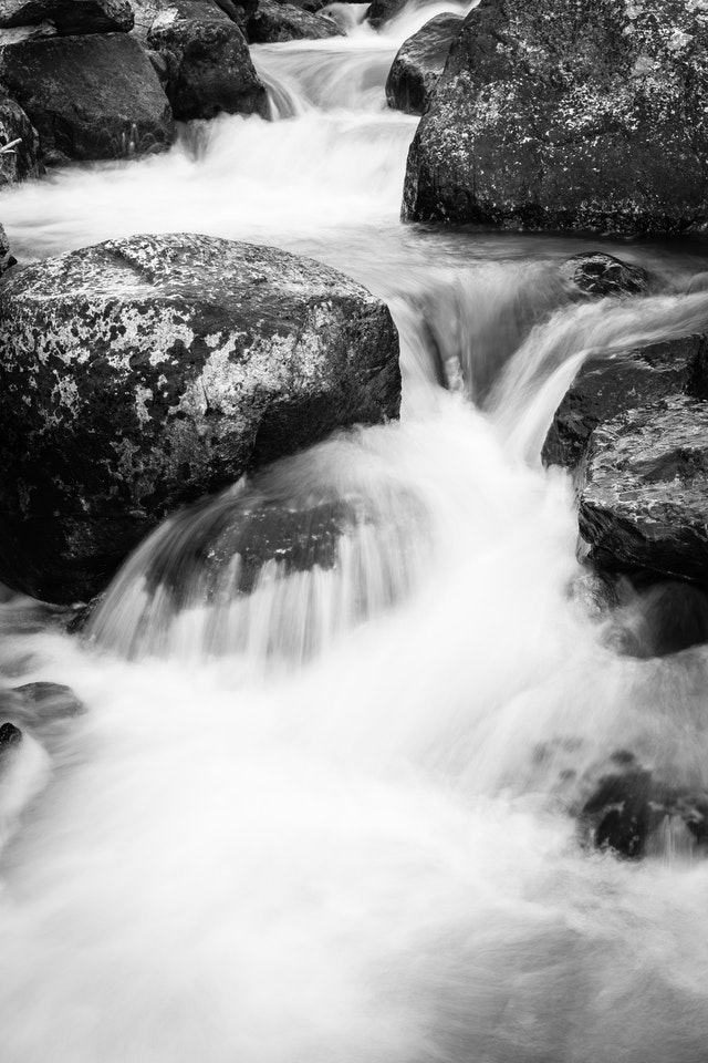 The waters of Taggart Creek running around some boulders.