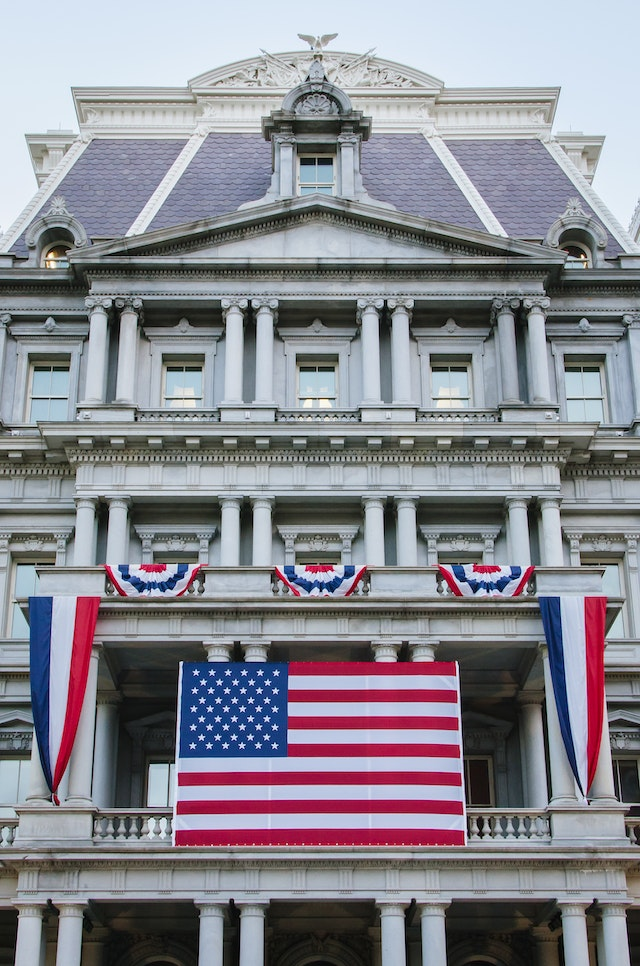 The Old Executive Office Building, covered in flags and buntings.