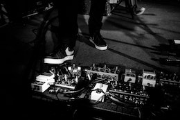 Billy Kennedy's feet on a pedalboard at a Frightened Rabbit concert at Black Cat.