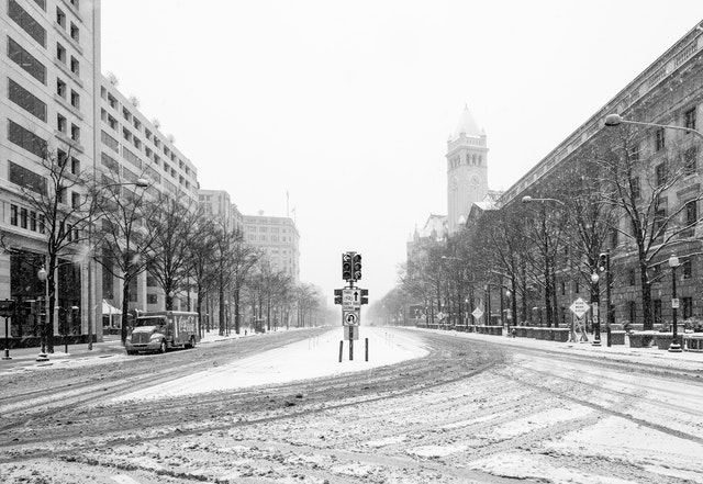 Pennsylvania Avenue, covered in snow, and looking towards the United States Capitol from Freedom Plaza.