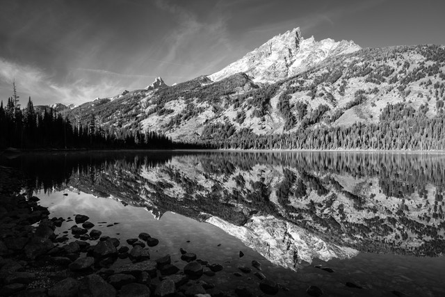 Teewinot Mountain reflected off the waters of Jenny Lake in Grand Teton National Park.