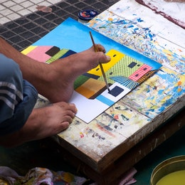 A painter without hands in Florida street, Buenos Aires, Argentina.