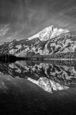 Teewinot Mountain reflected off the waters of Jenny Lake at Grand Teton National Park.