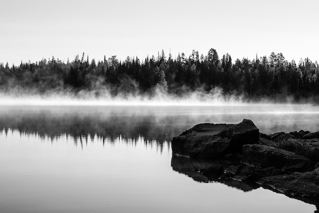 Morning mist rising from the surface of Leigh Lake.