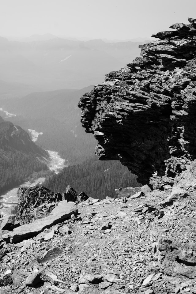 Jagged, volcanic rocks at the very top of the Skyline Trail in Mount Rainier National Park, with the Nisqually River in the distance.