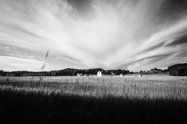 The DH Day Farm at Sleeping Bear Dunes National Lakeshore, under a sky streaked with clouds.