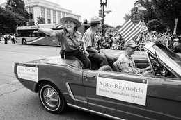 Gay Vietzke, Superintendent of the National Mall and Memorial Parks, and Mike Reynolds, Director of the National Park Service, riding on a Mustang at the Independence Day Parade in Washington, DC.