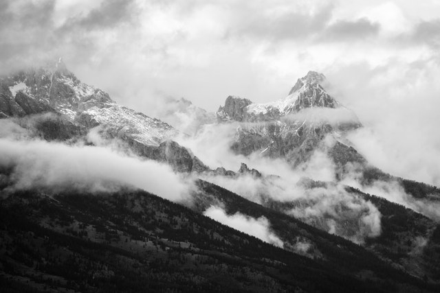 The Teton Range covered in clouds after a storm.