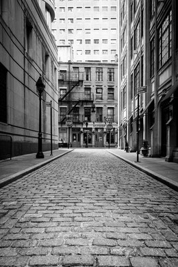 Looking down Mill Lane, a cobblestone road in the Financial District, at the intersection with Stone Street.