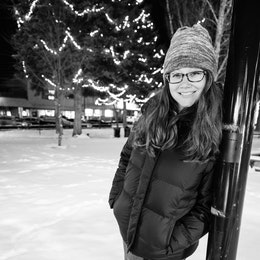 Kate posing in the snow in Jackson's Town Square.