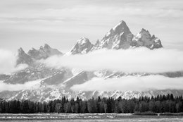 The Teton Range, partially covered by clouds, from Elk Ranch Flats