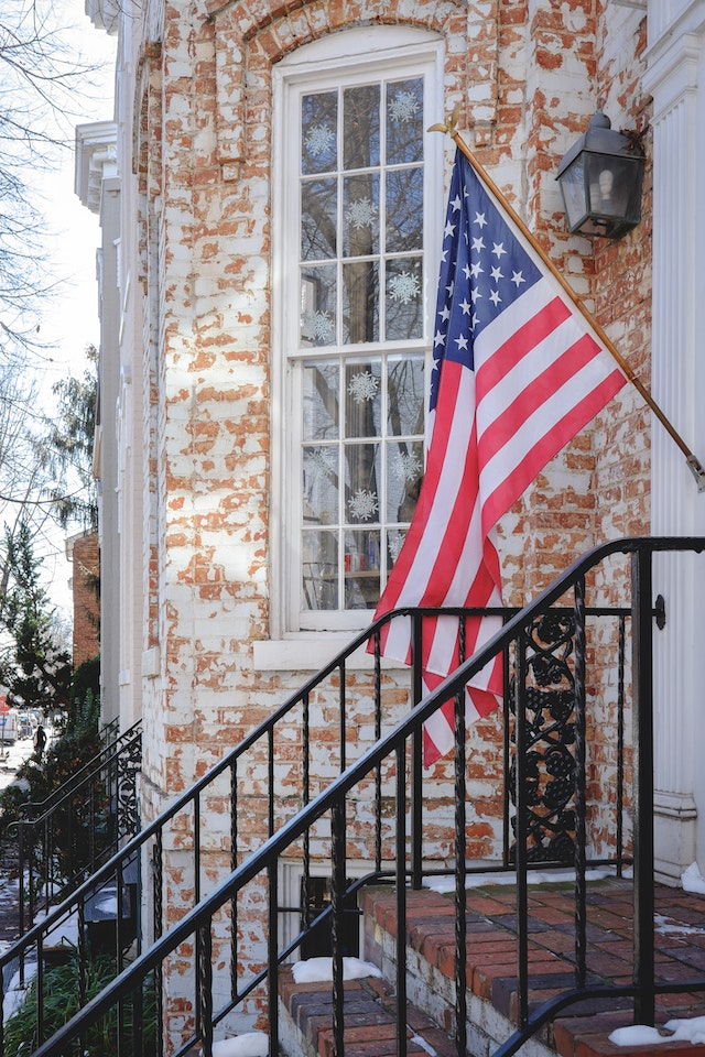 A flag flying in front of a row house in Georgetown.