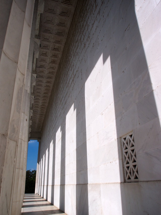 Shadows from the columns of the Lincoln Memorial.