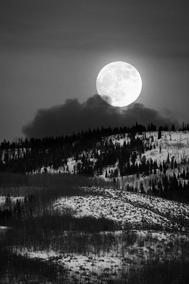 The full moon rising over the hills east of Antelope Flats during winter solstice.