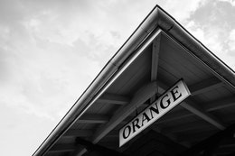 "An ""Orange"" sign at a train station in Orange, Virginia."