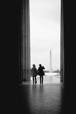 Tourist looking at the Washington Monument from the Lincoln Memorial.