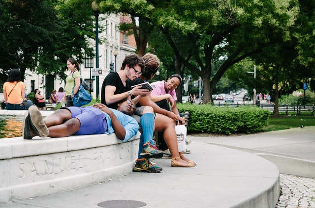 A group of young people hanging out in Dupont Circle, Washington, DC.