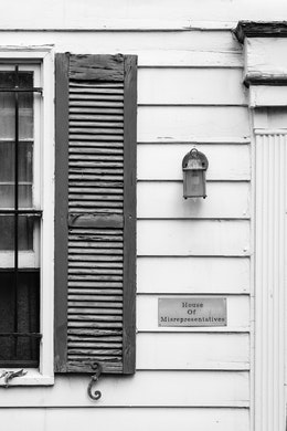 """A row house in Capitol Hill bearing a plaque that reads """"House of Misrepresentatives""""."""