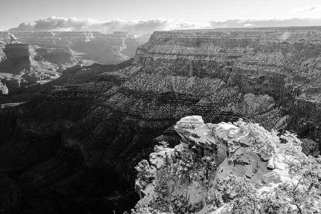 The South Rim towards Yavapai Point at sunrise, covered in snow, and seen from Trail View Point.