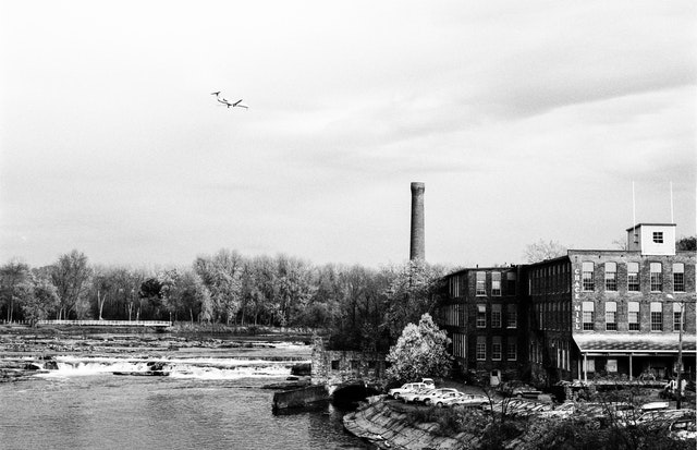 A plane flying over Winooski, Vermont.