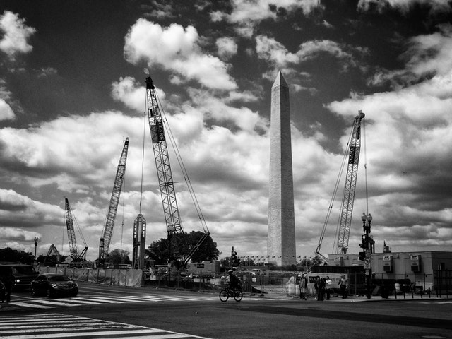 The Washington Monument, and a bunch of construction cranes at the National Museum of African American History and Culture construction site.
