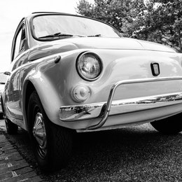 A vintage Fiat 500 parked in Georgetown.