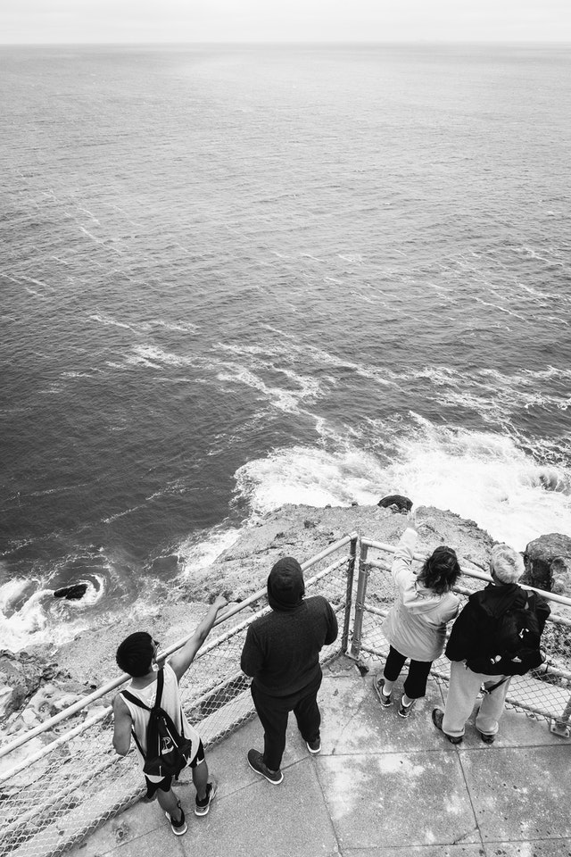 A group of visitors looking at gray whales from the Point Reyes Lighthouse.