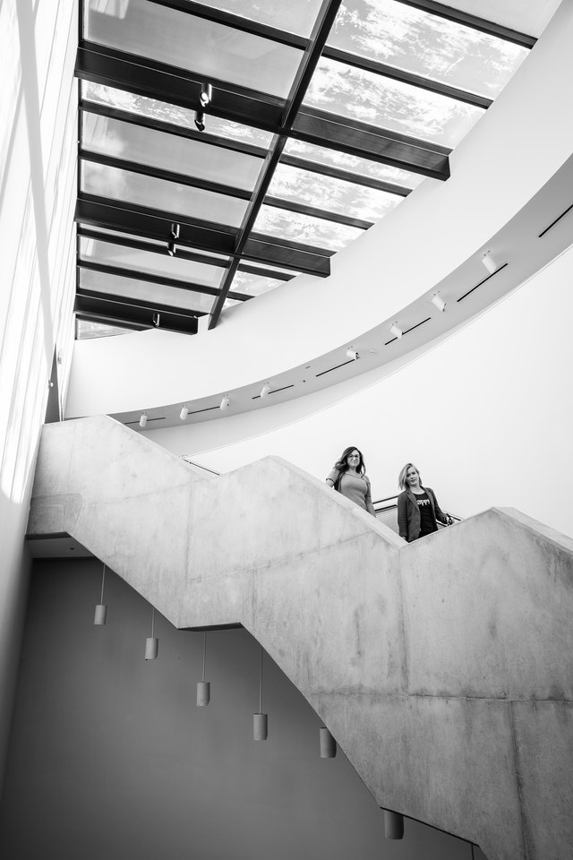 People walking down the stairs at the Katzen Arts Center at American University.