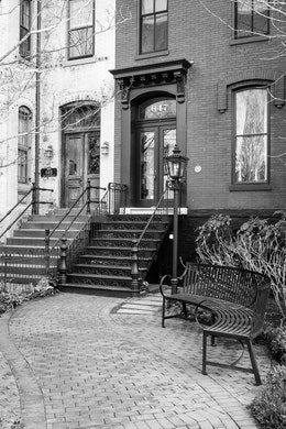 A curving pathway leading to a Capitol Hill rowhouse's doorstep.
