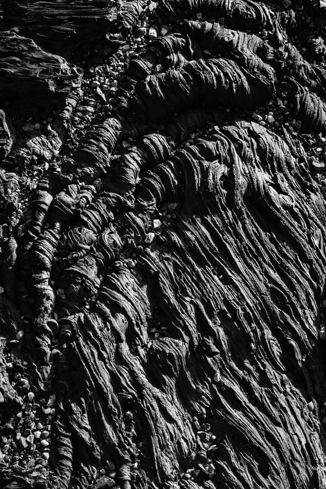 Detail of wavy, stringy pahoehoe lava along the Cave Area trail in Craters of the Moon.